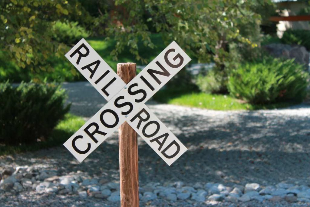 Railroad crossing warning sign warns drivers to help prevent a car accident